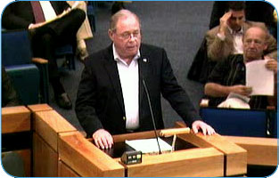 A man at the podium addressing the City Council during a meeting